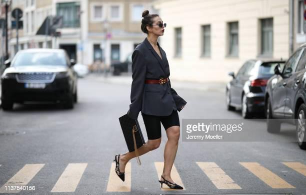 Masha Sedgwick wearing grey ami oversized blazer, Thomas Sabo necklace, Givenchy clutch, Topshop cycling shorts, Vintage belt, Tiffany earrings, Karl...