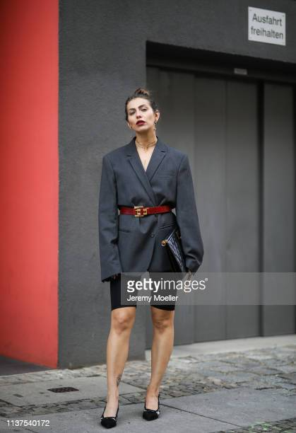 Masha Sedgwick wearing grey ami oversized blazer Thomas Sabo necklace Givenchy clutch Topshop cycling shorts Vintage belt Tiffany earrings Karl...