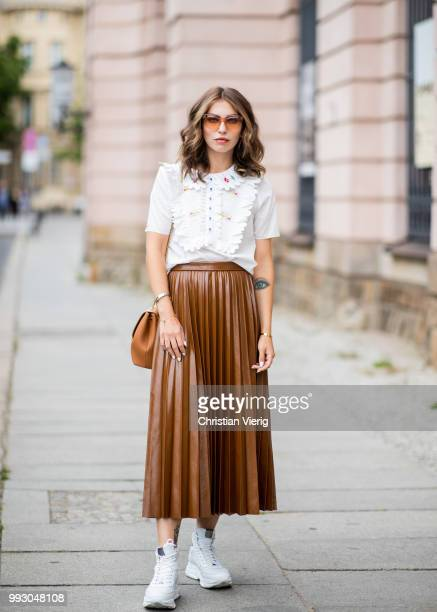 Masha Sedgwick wearing high waist brown midi skirt white ruffled blouse brown bag white sneakers seen outside Der Berliner Salon during the Berlin...