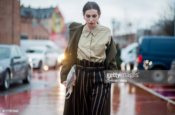 Masha Sedgwick wearing high waisted striped pants outside Freya Dalsjo during the Copenhagen Fashion Week Autumn/Winter 18 on January 31 2018 in...