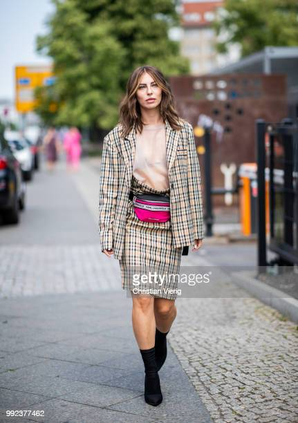 Masha Sedgwick wearing Karl Lagerfeld belt bag beige plaid blazer and skirt sock boots seen outside Marina Hoermanseder during the Berlin Fashion...