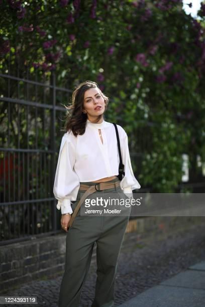 Masha Sedgwick wearing Lala Berlin bag, Nobi Talai shirt and Munthe pants on May 06, 2020 in Berlin, Germany.