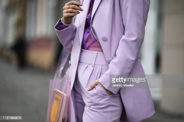 Masha Sedgwick wearing lilac blazer lilac trousers from 4th Reckless via Zalando Resume violet blouse via Asos Samsoe Samsoe plastic bag on March 19...