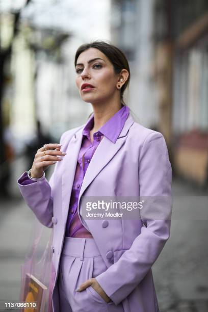Masha Sedgwick wearing lilac blazer & lilac trousers from 4th Reckless via Zalando, Resume violet blouse via Asos, Samsoe & Samsoe plastic bag on...