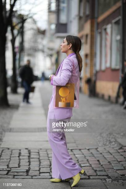 Masha Sedgwick wearing lilac blazer & lilac trousers from 4th Reckless via Zalando, Resume violet blouse via Asos, Anine Bing yellow boots, Samsoe &...
