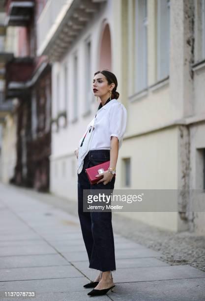 Masha Sedgwick wearing Lisou Pyjama silk shirt with puffed sleeves and back detail, Gucci scarf, red Miu Miu clutch, Levi's oversized Boyfriend wide...