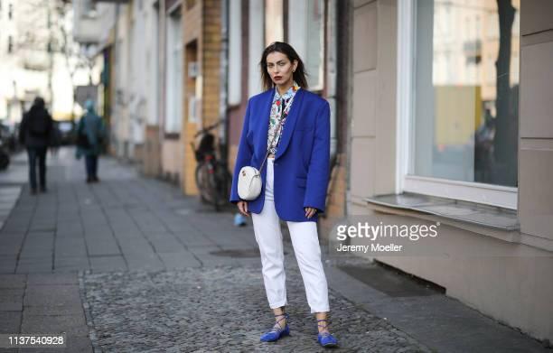 Masha Sedgwick wearing Maison Martin Margiela royal blue blazer Sandro printed shirt white Zara mom jeans royal blue Santoni ballerina shoes round...