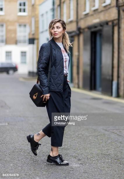 Masha Sedgwick wearing MaxCo striped pants a Kenzo bag white vintage tshirt jacket selected shoes Coliac outside Sharon Wauchob on day 4 of the...