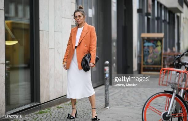 Masha Sedgwick wearing Mister Spex peach sunglasses Zara white midi skirt Acne Studio basic white tee Bottega Veneta Daniel Lee clutch Proenza...
