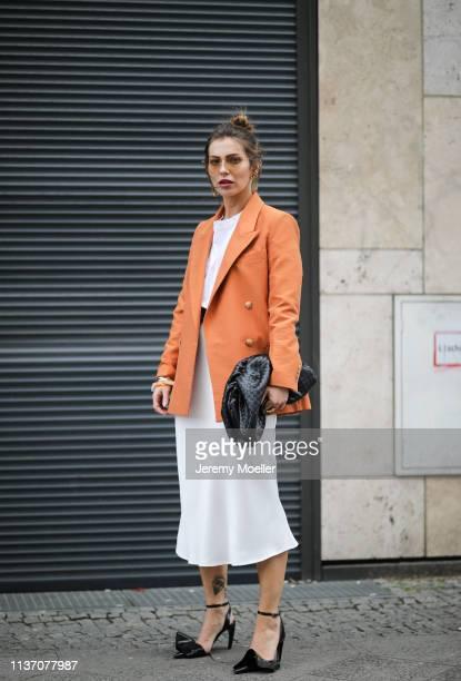 Masha Sedgwick wearing Mister Spex peach sunglasses, Zara white midi skirt, Acne Studio basic white tee, Bottega Veneta Daniel Lee clutch, Proenza...
