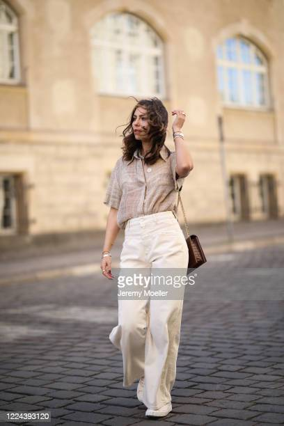Masha Sedgwick wearing Nobi Talai blouse, Agneel bag, Closed jeans and Coach sneaker on May 06, 2020 in Berlin, Germany.
