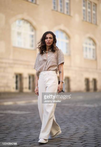 Masha Sedgwick wearing Nobi Talai blouse Agneel bag Closed jeans and Coach sneaker on May 06 2020 in Berlin Germany