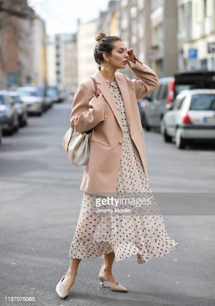 Masha Sedgwick wearing nude Baum und Pferdgarten maxi dress with dots and ruffles oversized Joseph pink blazer Tory Burch bucket bag Maria Black...