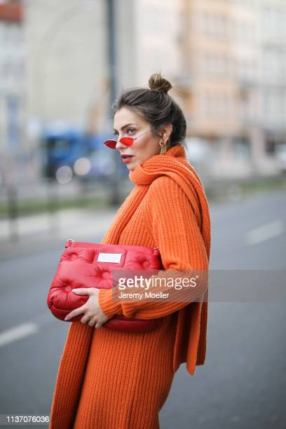 Masha Sedgwick wearing orange sweater dress via Asos Asos red mini sunglasses on March 19 2019 in Berlin Germany