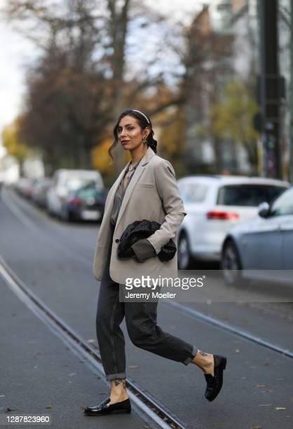 Masha Sedgwick wearing Pepe Jeans x dua Lipa black jeans, Bite blouse, Designers Remix blazer, Zara hair cuf, Bottega Veneta bag and Maison Margiela...