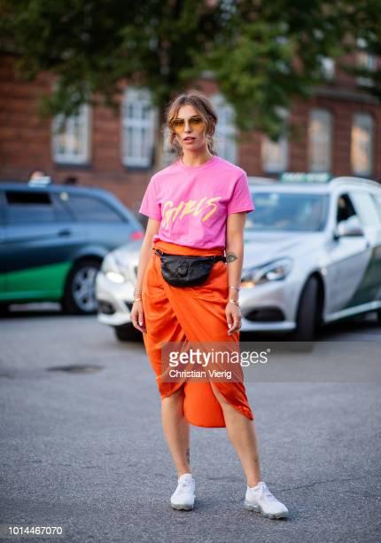 Masha Sedgwick wearing pink tshirt with print Girls midi skirt belt bag is seen outside Saks Potts during the Copenhagen Fashion Week Spring/Summer...