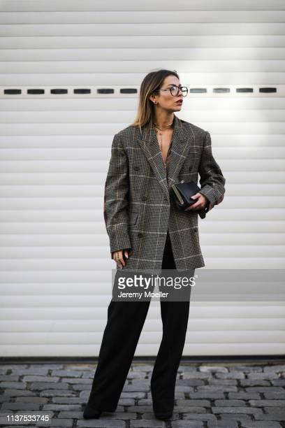Masha Sedgwick wearing PushButton oversized Blazer pattern mix, Zara Marlene black pants, Miu Miu clutch, Arket silk blouse, Thomas Sabo necklace,...