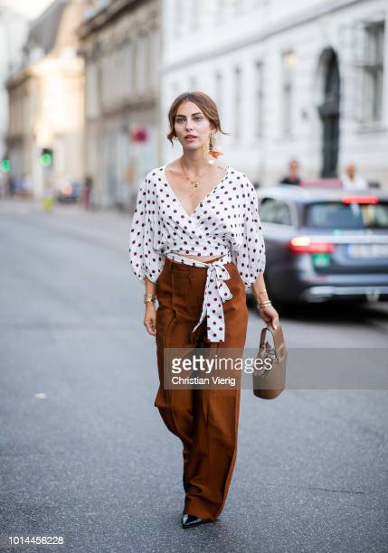 Masha Sedgwick wearing white blouse with dots prints and brown wide leg pants is seen outside Baum und Pferdgarten during the Copenhagen Fashion Week...