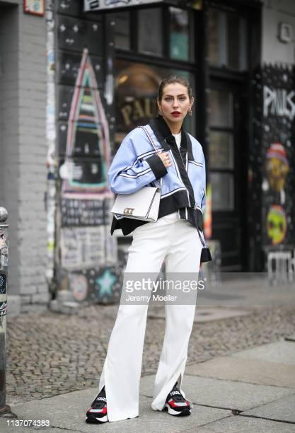 Masha Sedgwick wearing white Laurel pants blue SS19 Sportmax jacket white Furla bag Calvin Klein 205W39NYC white TShirt Karl Lagerfeld sneakers on...