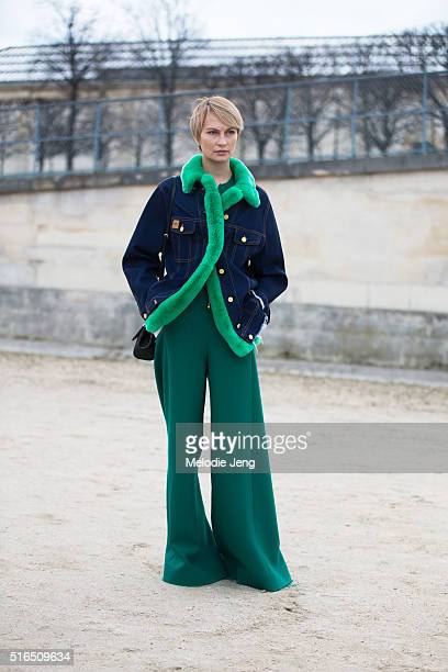 Masha Tsukanova wear Natasha Zinko including a denim jacket with green fur lining and widelegged green trousers at the Valentino show at the...