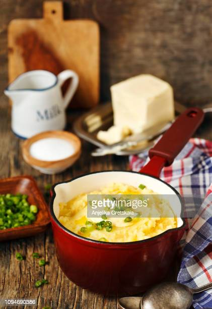 Mashed potato in cooking pan on wooden background, copy space