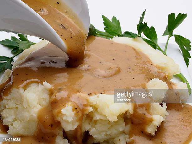 mashed potatoes and gravy - gravy stock photos and pictures