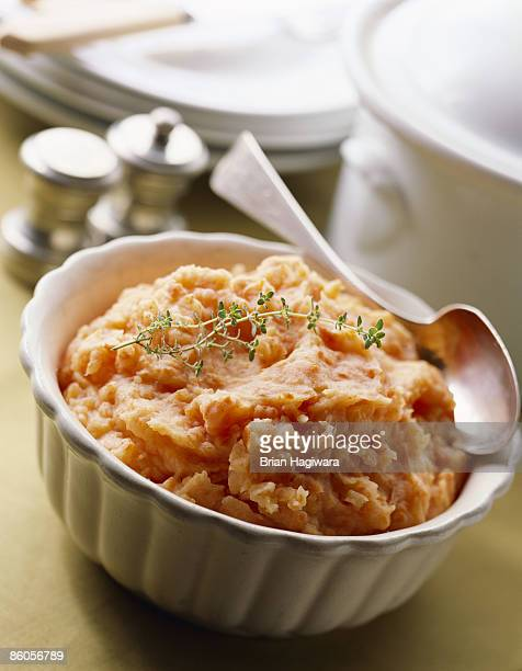 Mashed sweet potatoes garnished with thyme