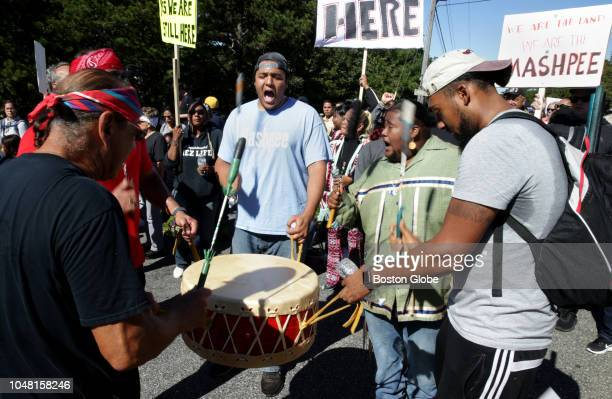 Mashpee Wampanoag marchers head to their traditional powwow grounds to hold a rally in Mashpee MA on Oct 6 2018 Nearly 200 members and supporters of...