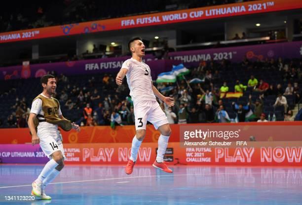 Mashrab Adilov of Uzbekistan and Paulius Osauskas of Lithuania celebrate the win during the FIFA Futsal World Cup 2021 group B match between Egypt...