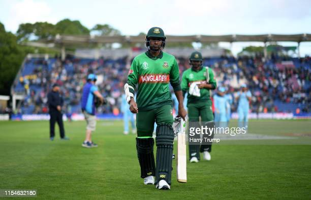 Mashrafe Mortaza and Mehedi Hasan of Bangladesh make their way off after defeat to England during the Group Stage match of the ICC Cricket World Cup...