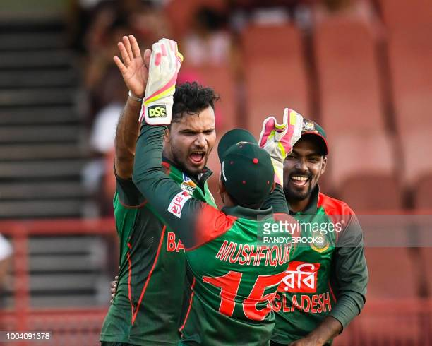 Mashrafe Mortaza and Nazmul Islam of Bangladesh celebrate the dismissal of Jason Holder of West Indies during the 1st ODI match between West Indies...