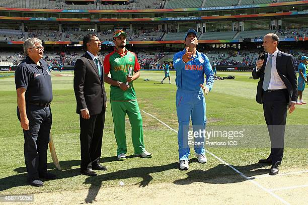 Mashrafe Mortaza of Bangladesh and MS Dhoni of India complete the coin toss during the 2015 ICC Cricket World Cup match between India and Bangladesh...