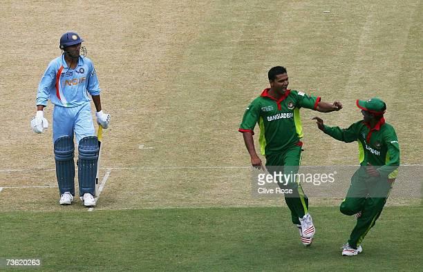 Mashrafe Mortaza of Bangladesh celebrates the wicket of Ajit Agarkar of India during the ICC Cricket World Cup 2007 Group B match between Bangladesh...