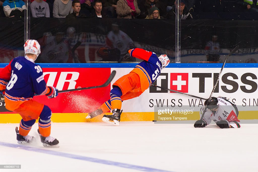 Masi Marjamäki of Tappara Tampere and #44 Pontus Widestrom of Frolunda Gothenburg battle for the puck during the Champions Hockey League round of 16 first leg game between Tappara Tampere and Frolunda Gothenburg at Hakametsa on November 4, 2014 in Tampere, Finland.