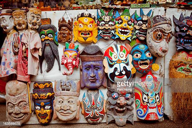 mask dolls for sale at street stall - chinese mask stock photos and pictures
