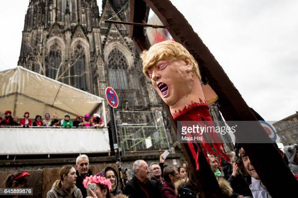 A mask featuring US President Donald Trump is seen in the annual Rose Monday parade on February 27 2017 in Cologne Germany Political satire is a...