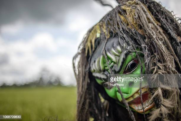 A mask in a paddy field at the village near Ubud Ubud District Bali Indonesia in November 2018