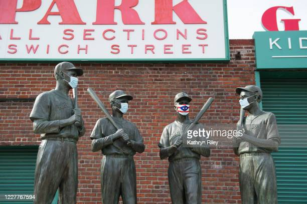 Mask is placed on the Teammates Statue on Ispwich Street on Opening Day at Fenway Park on July 24, 2020 in Boston, Massachusetts. The 2020 season had...