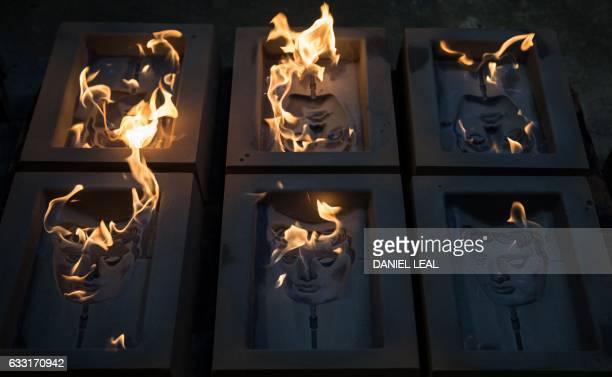 mask moulds are set alight to burn off any impurities before casting during a photocall at the New Pro Foundries west of London on January 31 2017...