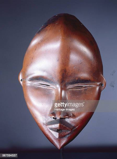 Mask of a type called Deangle, which collects food from village women and brings it to boys secluded in the bush circumcision camp. Regarded as...