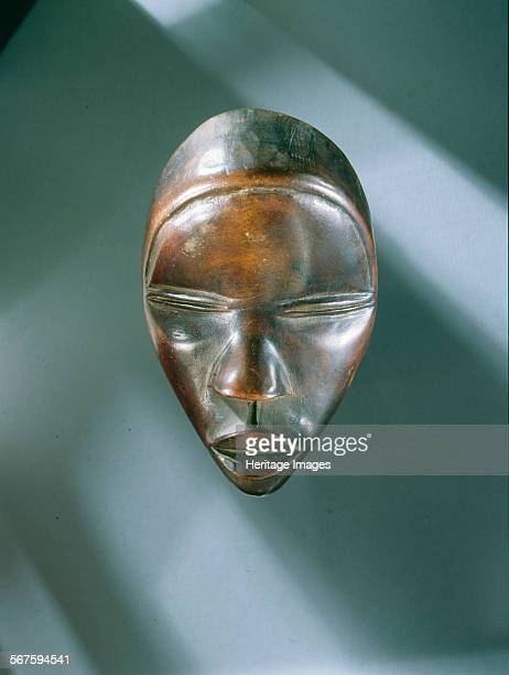 Mask of a type called Deangle which collects food from village women and brings it to boys secluded in the bush circumcision camp Regarded as female...