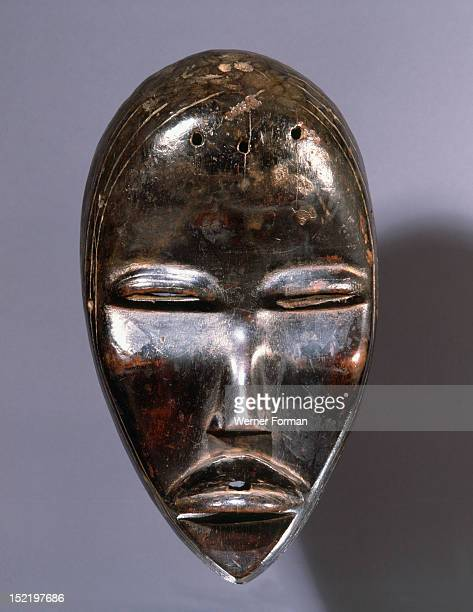 Mask of a type called Tankagle which probably depicts a handsome young man Often accompanied by musicians they entertain spectators with dance and in...