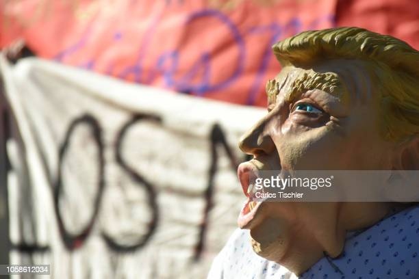 A mask of Donald Trump looks during the Mexicans meet outside the United States Embassy to plan a welcoming and gather donations for the migrant...