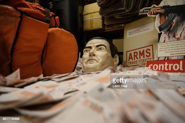 A mask of former Chancellor of the Exchequer George Osborne is seen in a pile of fake currency in the store room at Oxfam's headquarters on October 4...