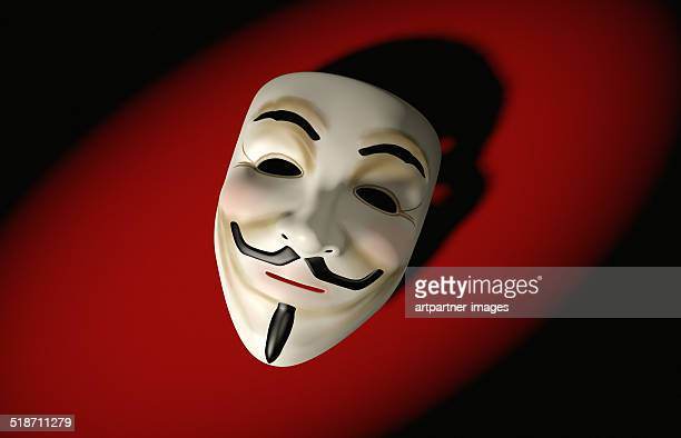 mask of guy fawkes on red - guy fawkes stock photos and pictures