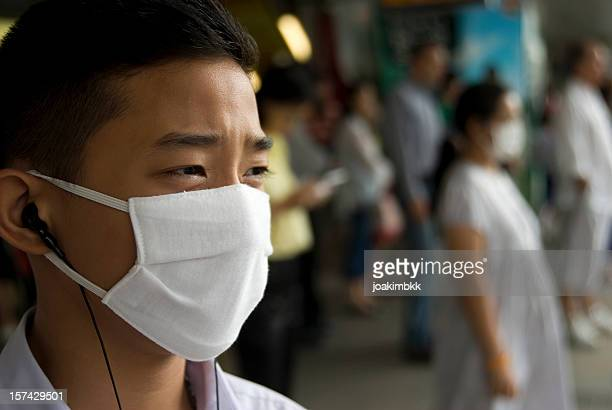 a mask to cover the faces of those affected with swine flu - plague stock photos and pictures