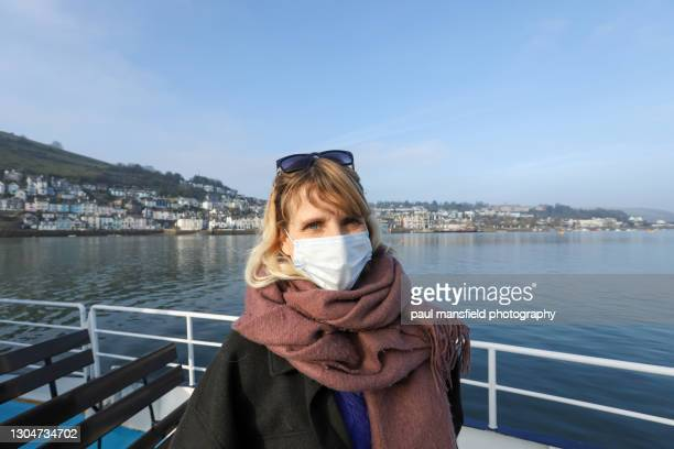 mask wearing woman on dartmouth passenger ferry - passenger craft stock pictures, royalty-free photos & images