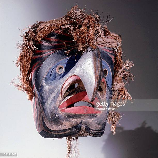Mask with a human face and eagle beak representing an ancestor that came to earth as an eagle According to Bella Coola mythology four carpenters were...