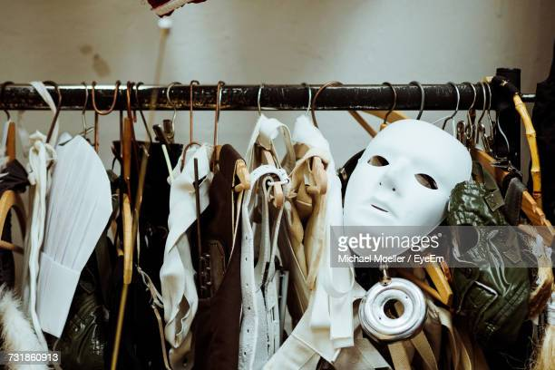 mask with costumes hanging on rack - kulisse bühne stock-fotos und bilder