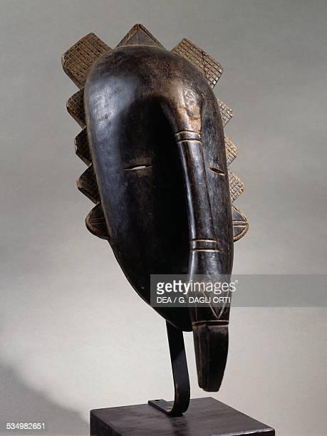 Mask with hornbill beakshaped nose Senufo tribal emblem forest spirit Kulango or Kulamvo people Ivory Coast